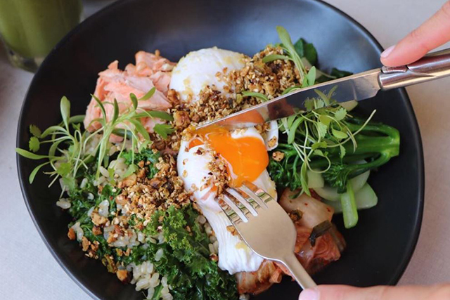 Indigo, Double Bay: Indigo serves up a green breakfast bowl that people travel long distances for – it's that good. Filled with Asian green veg, pickled cucumber, kale, brown rice, poached eggs and kimchi it's the real green deal. (Image: @indigodoublebay)
