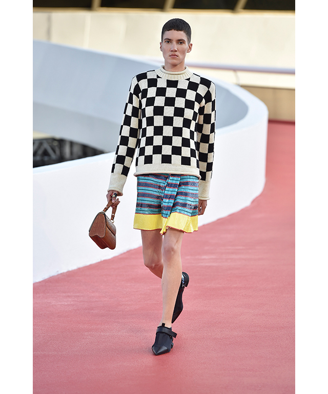 The collection has a clear Grand Prix influence, most obvious by way of black and white checked flag prints on men's jumpers and leather bags.