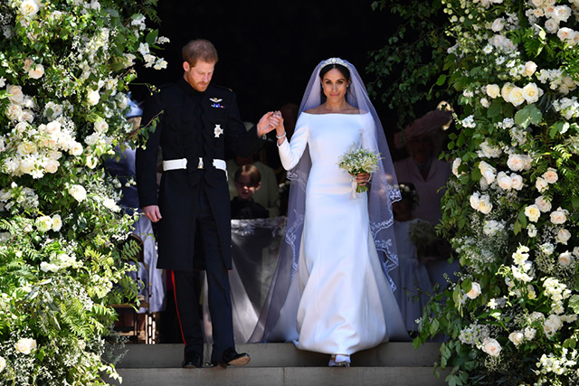 Markle wore a custom haute couture silk boat neck wedding gown with three-quarter sleeves designed by Clare Waight Keller for Givenchy. Her headpiece of choice was a five-meter silk tulle train hand-embroidered with flowers, anchored with the Filigree tiara that once belonged to Queen Mary.