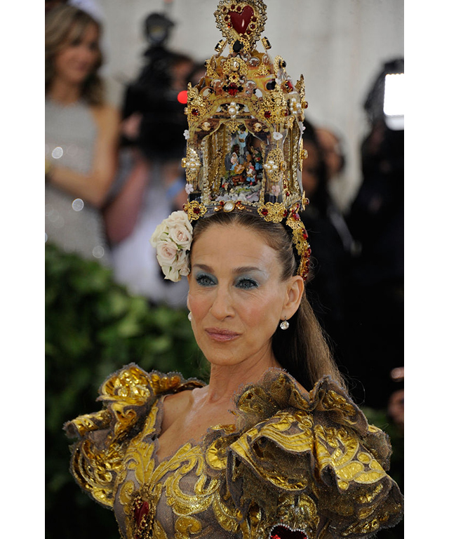 Sarah Jessica Parker wore gold Dolce & Gahanna but the real talking point was her headpiece complete with a nativity scene. Image credit: Getty Images.