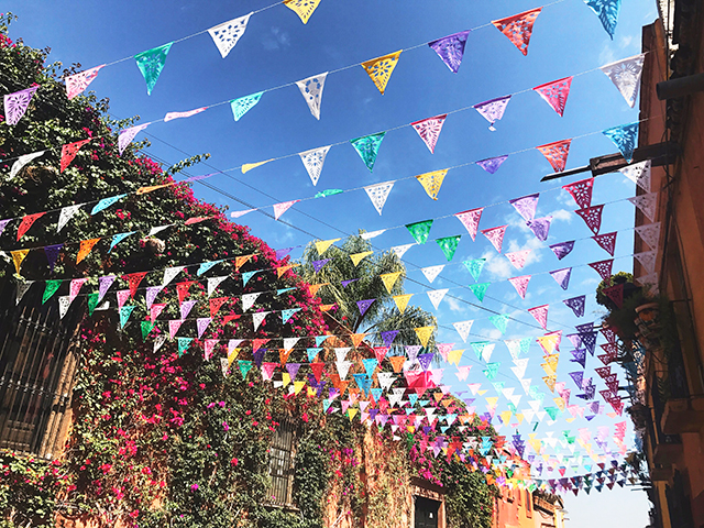 Papel picado banners creating a colourful sky.