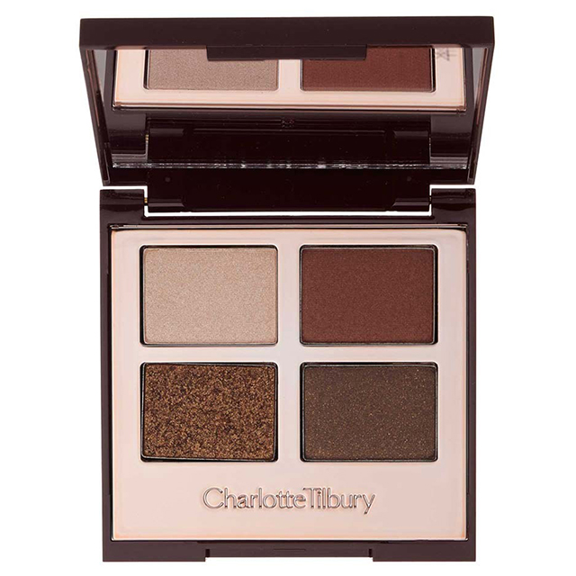"Eyeshadow: ""Usually I'll grab this Charlotte Tilbury Luxury Eye Palette in Dolce Vita, which I'm in love with. I use the rosy highlighter shade on the lid and then I do the red all around, and I blend in the crease with a Charlotte Tilbury blending brush."""