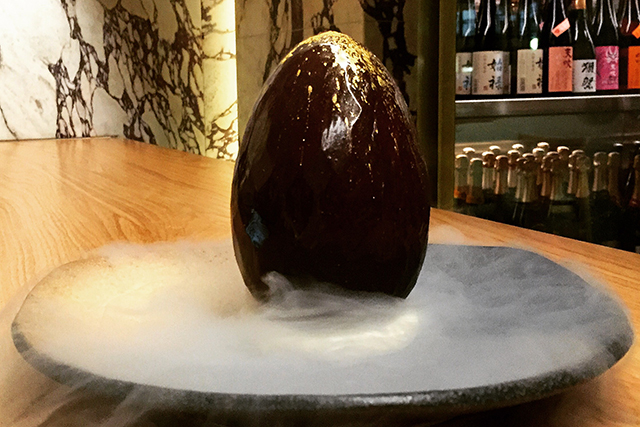 Chocolate dragon egg, Saké Sydney: Chocolate and chemistry cleverly come together for Saké's signature dessert. 100% edible chocolate egg casing hides an epic interior of dark choc mousse, passionfruit ice cream and mango caramel.