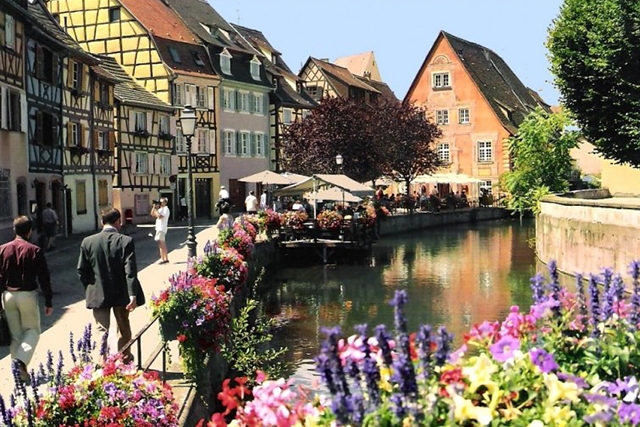 Colmar: This pretty town in France's Alsace region is paved with cobblestone streets and romantic Renaissance and medieval architecture.  Charming canals and a flower-filled town centre mark this wine region as a bucket list addition.