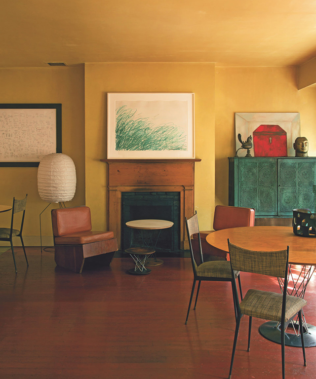 The home of Francesco Clemente: a drawing by Cy Twombly over the fireplace is flanked by a Jean-Michel Basquiat drawing and a painting by Clemente in the dining area.