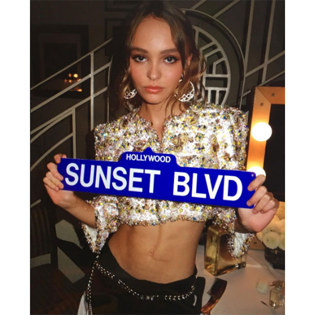 Lily Rose-Depp @lilyrose_depp; (Chanel x head-to-toe) + midriff + doorknocker earrings = Chic AF