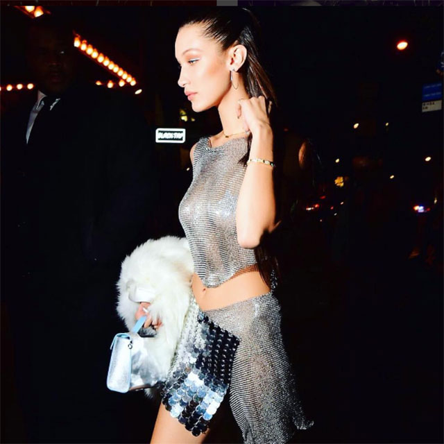 Bella Hadid @bellahadid; (Chainmail + oversized pailettes + purse) x silver = Futuristic festive
