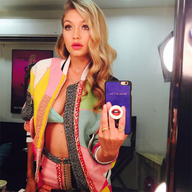 Gigi Hadid @gigihadid; Hypercolour two-piece – blouse = Rainbow riot girl