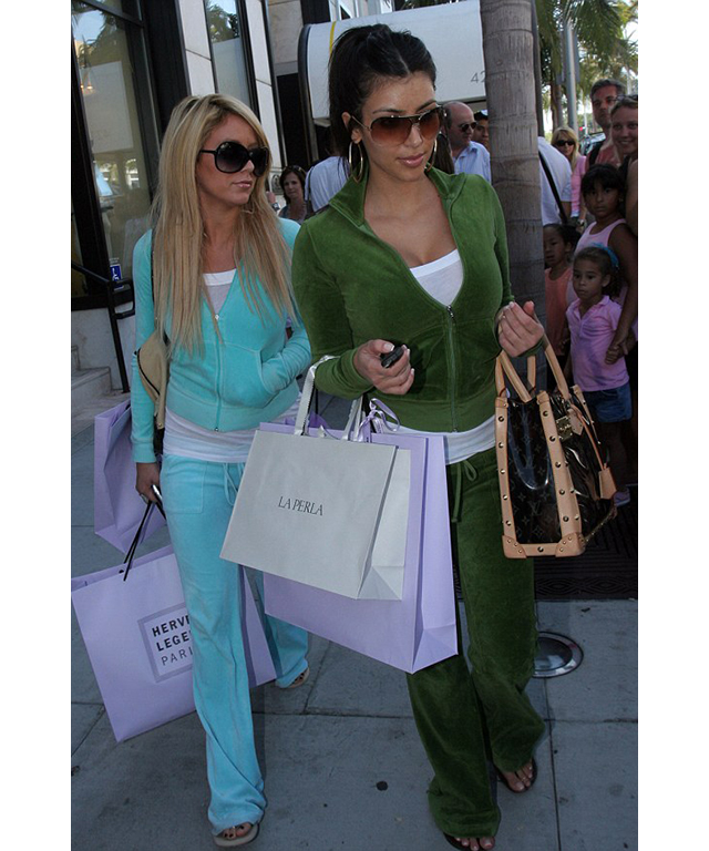 Here's a pre-fame Kim K, presumably shopping for Paris in a fetching green number that matches her friend.