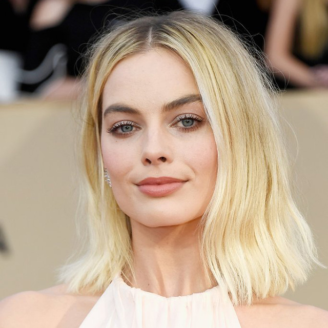 "Bright blonde: The epitome of old Hollywood glam, bright blonde is your secret to that ""lit-from-within"" glow, 24/7. Ideal for fairer skin tones, Jaye says this hair hue will lift your game in 2018 to Margot Robbie status-level."