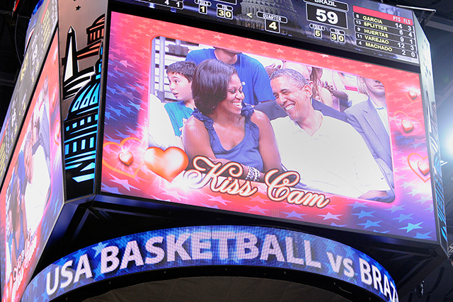 The Obamas appear on the 'Kiss Cam' at a basketball game on July 16, 2012 in Washington, DC