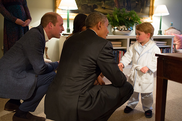 President Barack Obama, Prince William, Duke of Cambridge and First Lady Michelle Obama talk with Prince George at Kensington Palace on April 22, 2016 in London, England