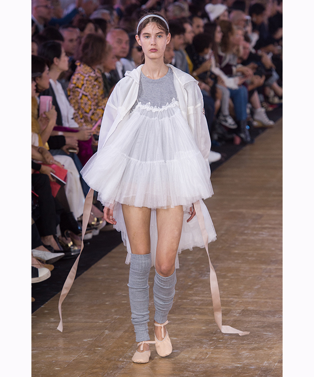 Tulle extended into the runway collection with delicate dancing skirts paired back with streetwear.