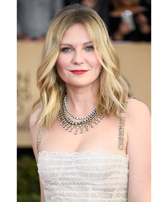 "Relaxed ""natural"" waves: Gone were the days of the shouty, tight, Prom-queen curls, as this year's red carpet was all about relaxed brushed out waves that were effortlessly let loose or parted and pulled back."