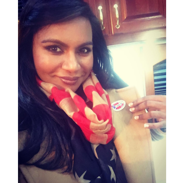 Mindy Kaling sports the stars and strips on her scarf.
