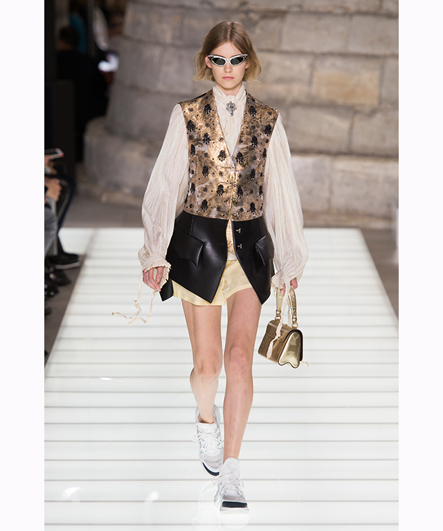 Classic French tailoring had a futuristic twist with the inclusion of sports sunglasses and metallic undergarments.