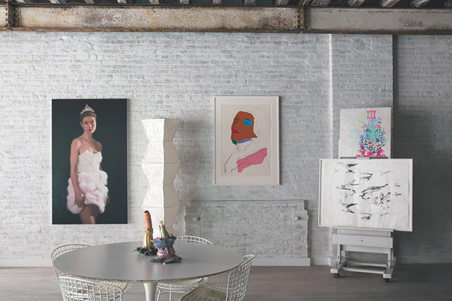 The home of artist Will Cotton. His 2010 painting of his partner, Rose Dergan, coexists with works by Andy Warhol and Ryan McGinness. Ceramics by artist Linda Lighton, who happens to be Dergan's mother, are on the table.
