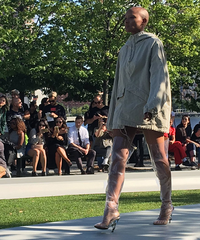 Kim's plastic Yeezy boots make their runway apearance