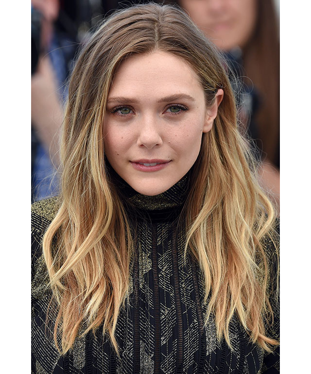Elizabeth Olsen: The actress opted for natural tresses and barely-there make-up.