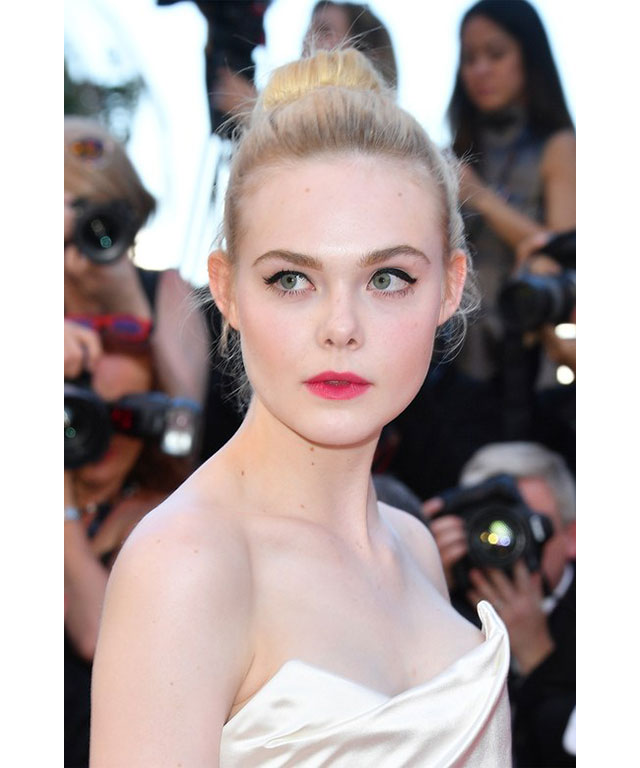 Elle Fanning: A pop of pink was all Elle Fanning needed to steal the show. Her bright magenta lip was teamed with a perfect cat-eye, which was highlighted thanks to her slick top knot.