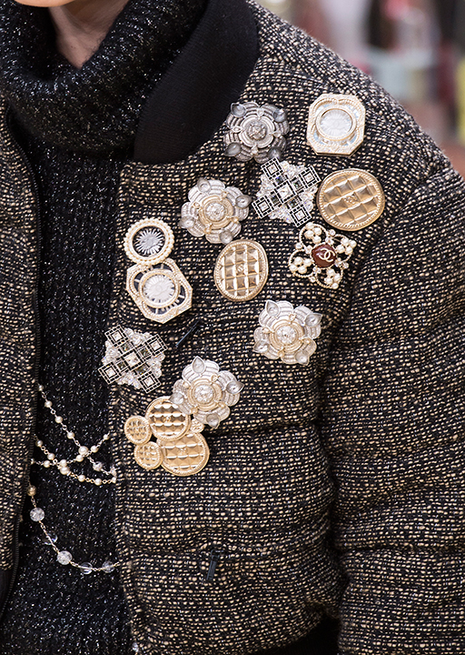 Chanel:  Metallic brooches