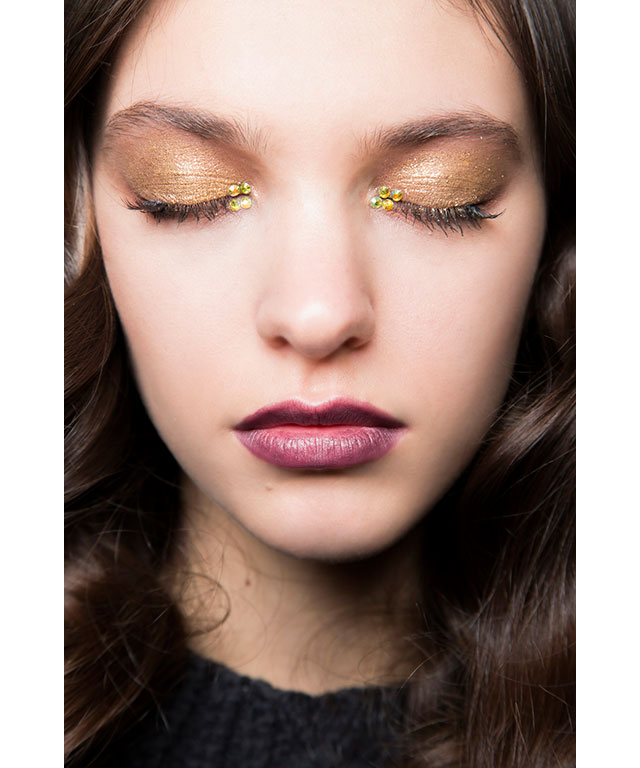Embellished metallic gold shadow at John Richmond A/W 16