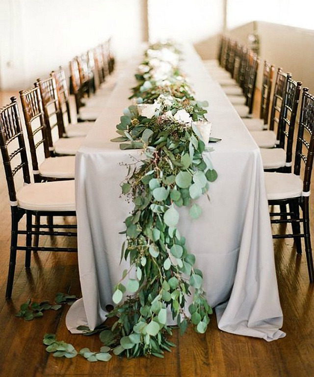 GO GREEN: Brides are foregoing traditional floral arrangements for simple scatterings of greenery arrangements like ivy or eucalyptus.