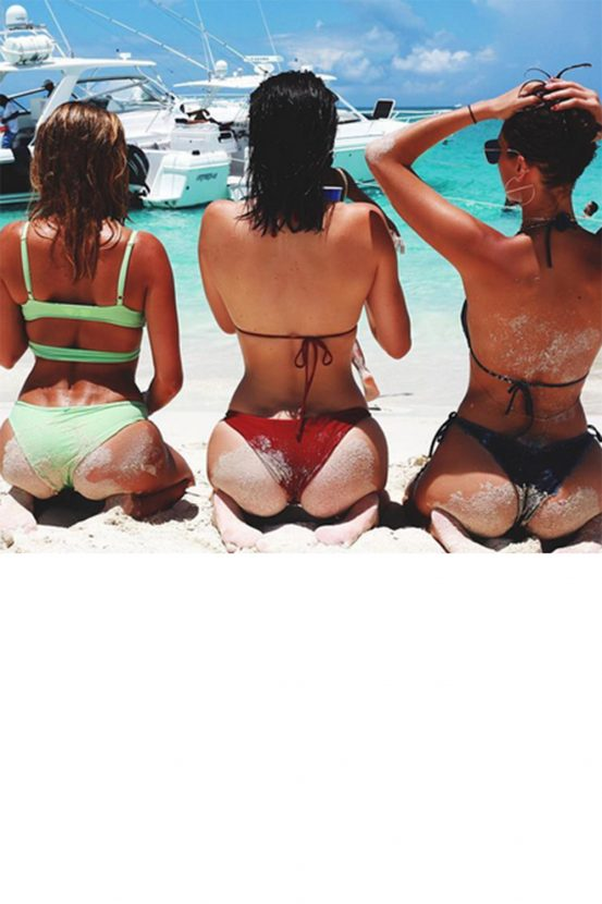 Bella Hadid being cheeky with Kendall Jenner and Hailey Baldwin in Barbados / @bellahadid