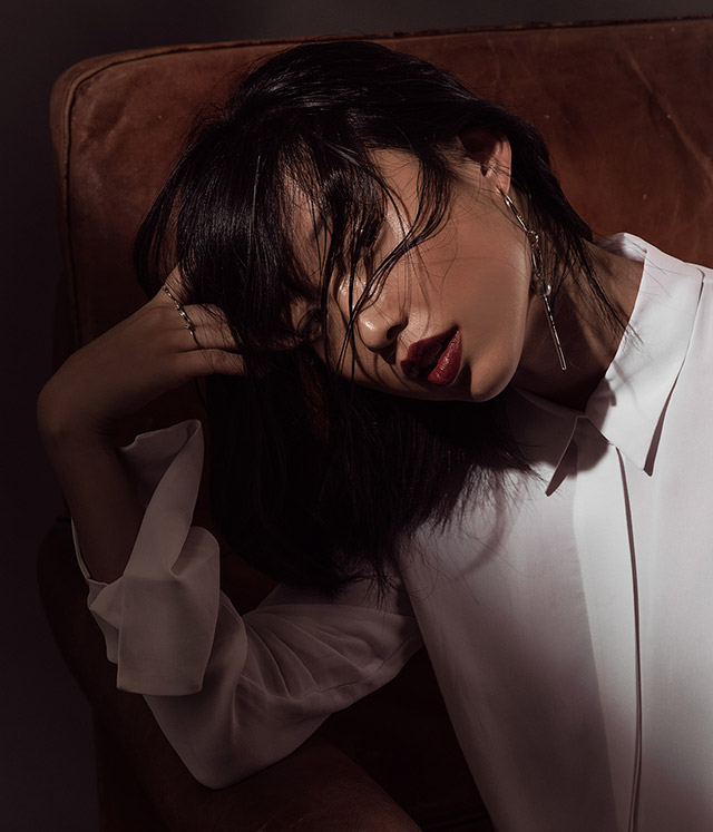 "Margaret Zhang (self-portrait), photographer, creative consultant, writer and stylist: ""I wear a white shirt because this message deserves to be heard and this fight is worth fighting. If my work can open people's eyes to this critical need, and give often voiceless victims a voice, then that's something worth doing."""