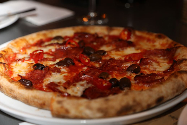 Go for broke with their take on 'pizza with the lot' - Il Capitano, a tomato based beauty topped with San Marzano tomatoes, Italian fior di latte, truffle oil, goats cheese, Swiss roasted mushrooms and Italian pork and fennel sausage.