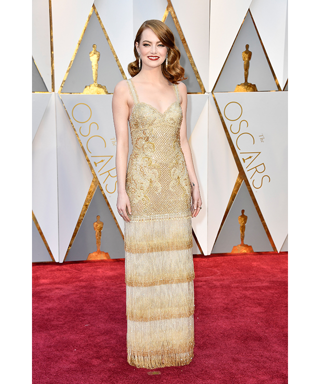 Emma Stone wearing Givenchy couture and Tiffany & Co. jewels