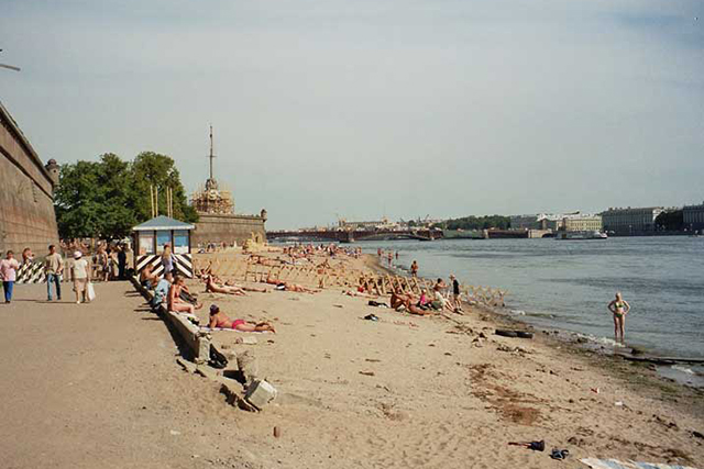 "HANGOUT: ""Saint Peter and Paul's fortress beach in summer has amazing views across the Neva river towards the Hermitage Palace."""