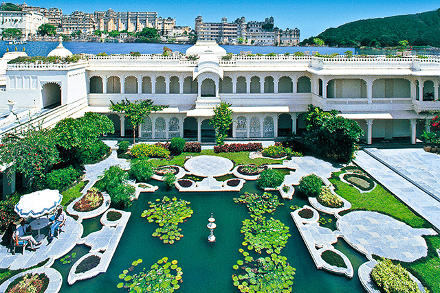 Taj Lake Palace, Udaipur, India. In the middle of a lake in Udaipur, this palace has dining options worth the jet boat ride – a gazebo by the lily pond, a balcony overlooking the lake, or a private pontoon with white linen and all the trimmings.