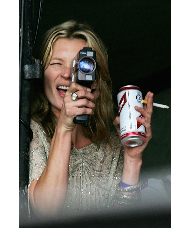 Kate Moss films boyfriend Pete Doherty at Glastonbury festival, 2005
