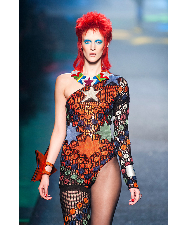 Jean Paul Gaultier's S/S '13 show was an all-out Bowie love fest: models walked to the sounds of 'Fashion' wearing clothes that could only come from Ziggy Stardust's wardrobe.