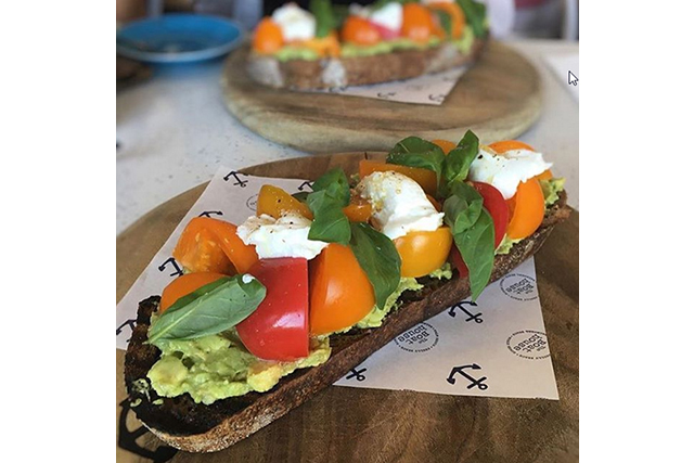 Avocado and tomato on charred toast with goats curd and basil, The Boathouse