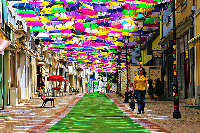 Agueda, Portugal: The Agueda umbrella installation floats up every July and it's the real deal rainbow.
