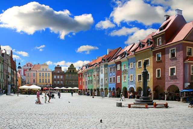 Poznań, Poland: A renaissance town showcasing flawless old time architecture in tinted picture-perfection.