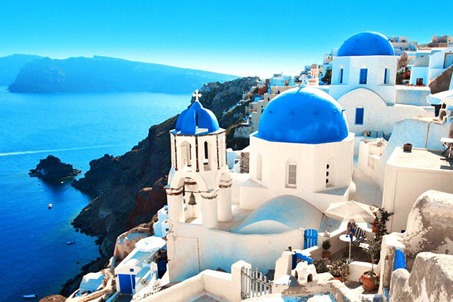 Santorini, Greece: Fresh blue and white is the perfect palette for stunning Santorini in the idyllic Greek Islands.