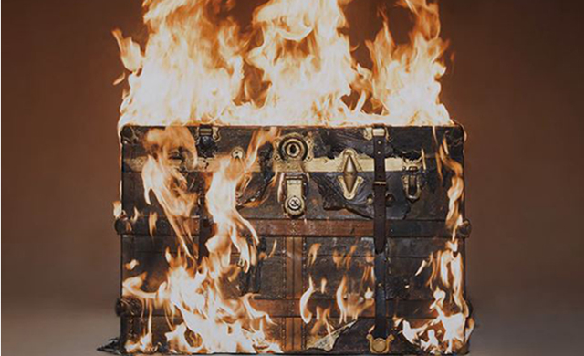 Watch a $15,000 Louis Vuitton trunk go up in flames in the name of art