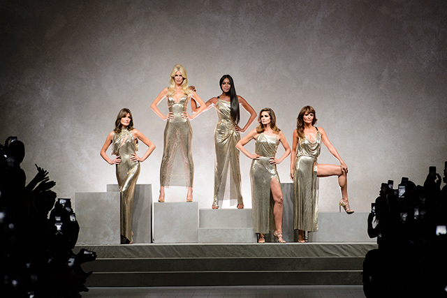 Next minute, it's curtains as Donatella Versace takes her finale walk down the catwalk flanked by some serious Super power: Carla Bruni, Cindy Crawford, Claudia Schiffer and Helena Christensen to the George Michael anthem Freedom!.