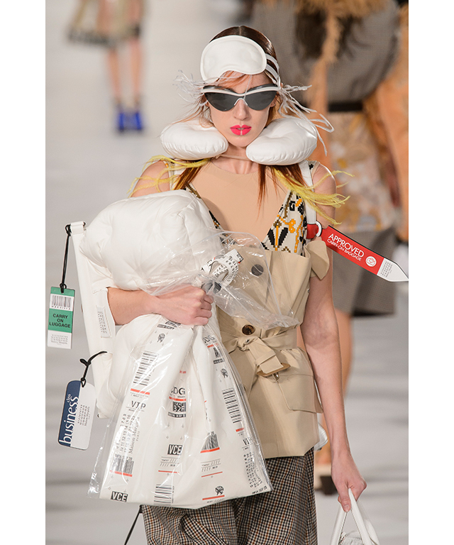 Accessories were stamped with 'Priority' tags (because accessories should always be a priority) and models were adorned with neck pillows and eye masks.