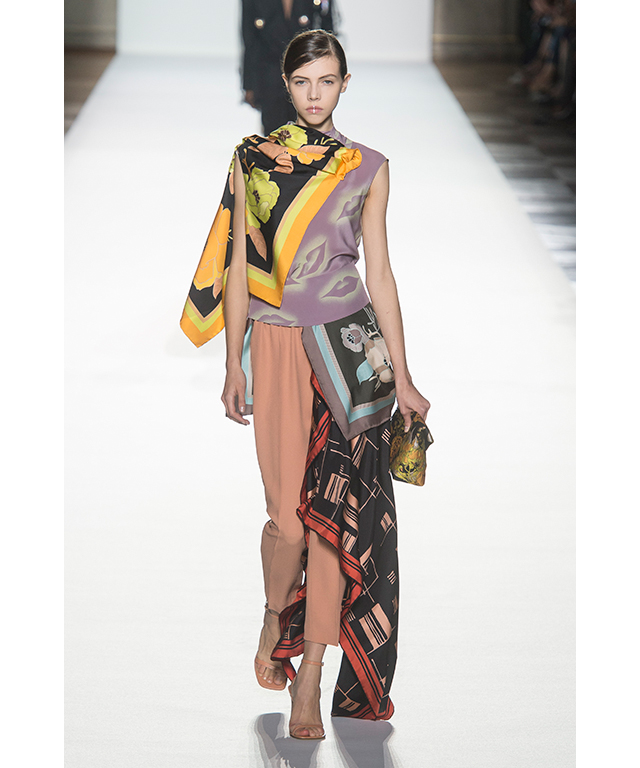 Dries van Noten: 'How many ways can you wear a scarf?' someone must have asked Dries van Noten. His S/S '18 collection proves the answer is 'a lot'. From swishy skirt hemlines, printed scarf tops and wrap style dresses the designer proved that versatility is boundless.