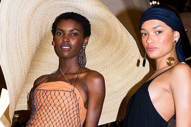 Jacquemus' Rio-ready dewy skin achieved by buffing a mix of brown, burgundy and red lipsticks onto the cheeks, using the fingers