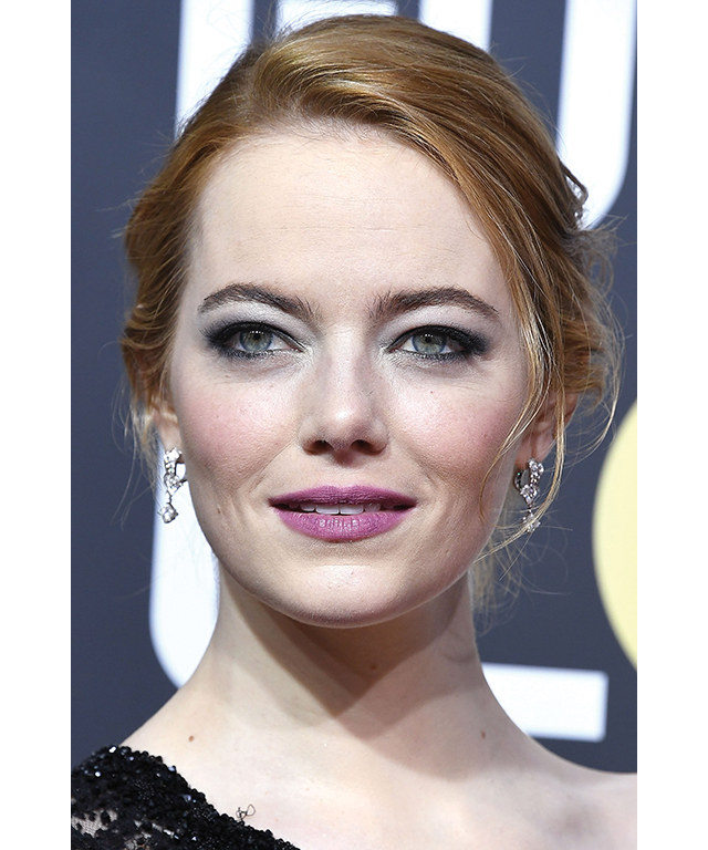 "Easy up-style inspo: Emma Stone. ""Quick and easy up-styles are the key to achieving casually elegant looks with minimal effort,"" says Murphy. (Image: Steve Granitz/WireImage)"