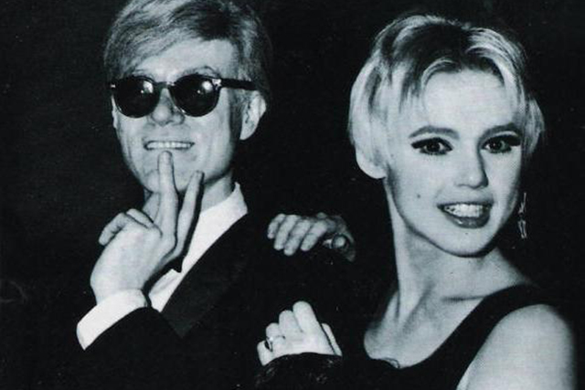 Andy Warhol and Edie Sedgwick.   Edith Minturn 'Edie' Sedgwick was an American heiress, socialite and actress, best known for being one of Andy Warhol's muses. All the self-dramatising of Andy Warhol's world was epitomised by its starriest of superstars setting fire to her room at the Chelsea Hotel in 1966. Despite a warning from Leonard Cohen, Sedgwick fell asleep with candles burning and was thereafter considered such a liability by the hotel's staff that they moved her into a room above the lobby, where she could be monitored. The footage of Sedgwick shot for Warhol's movie Chelsea Girls (filmed in the hotel) was removed in the end and that same year she suffered a nervous breakdown and moved out of the hotel.