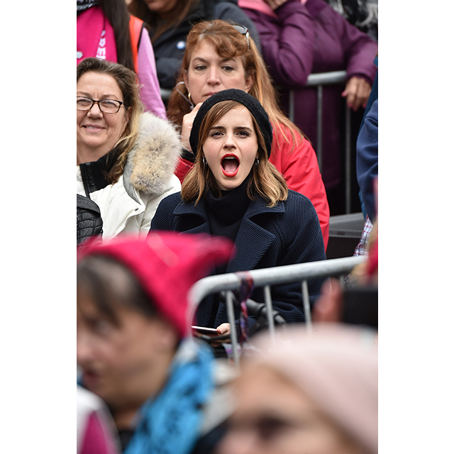 Emma Watson cheered from the crowd during the Washington march.