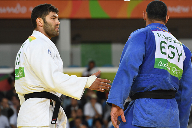 "No Olympic Spirit: Egyptian judo handshake refusal, At the other end of the Olympic spirit spectrum was Egypt's judo star Islam El Shehaby, who refused to shake the hand of the man who had just beaten him,  Israel's Or Sasson. El Shehaby  later said that ""handshakes happen between friends"" and Sasson did not fall into that category for him.  He was later sent home in disgrace. If there was an Olympics medal available for being a sore loser, El Shehaby would have taken gold."
