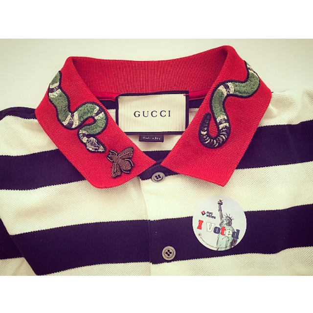 Derek Blasberg decorates his Gucci with a vote pin.