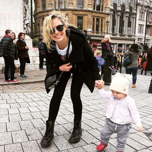 She's family oriented, as seen here with a mini member of partner Tom Ackerley's family.